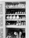 Shoes in Cabinet in Storage